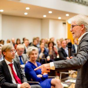 Pieter van Rest tijdens rio-symposium 2018